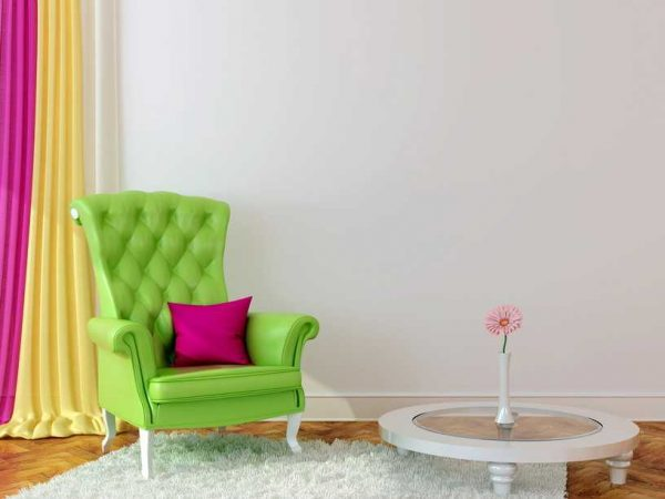 Bright interior with green armchair and colored curtains creates a spring mood